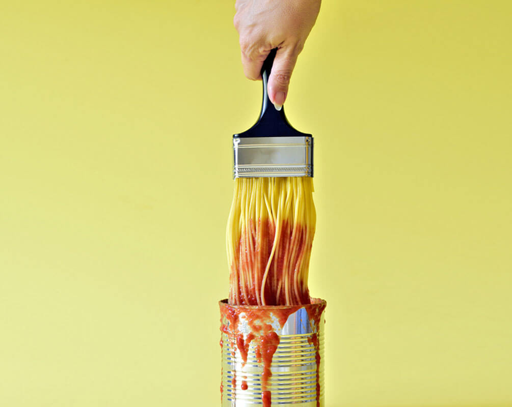 Multichannel Spaghetti attached to a paintbrush dipped in a can of secret digital ingredients the best tomato sauce to success